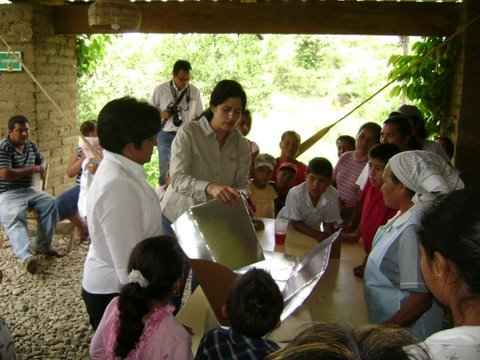 Women learning how to set up the solar energy cooker