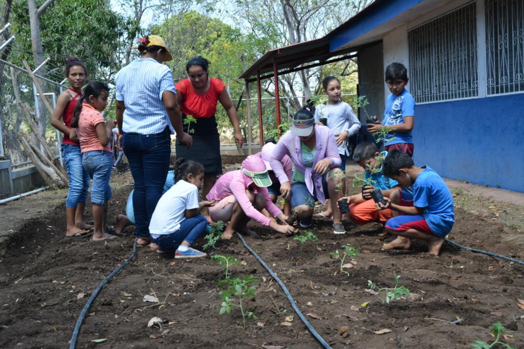 San Antonio School students planting their garden