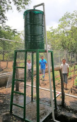 Elevated tank powers drip irrigation by gravity
