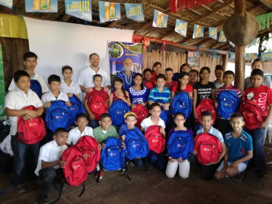 Students with SosteNica backpacks