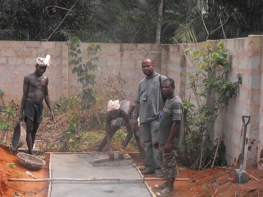 Construction of latrine slabs in progress