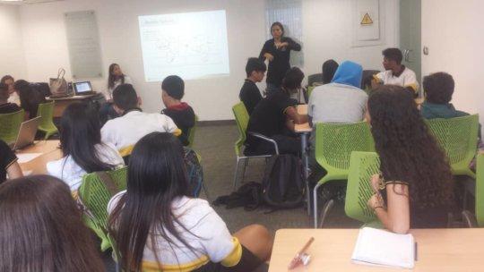 Explaining their solutions at program's journ end