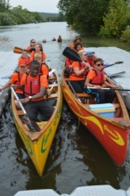 Sibling group canoe challenge