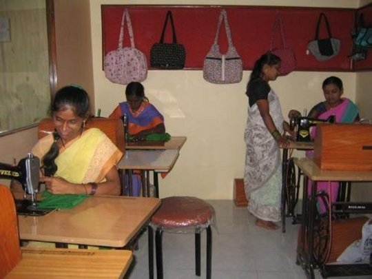 Women learning how to make cotton bags