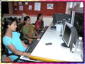 Women participating in computer class