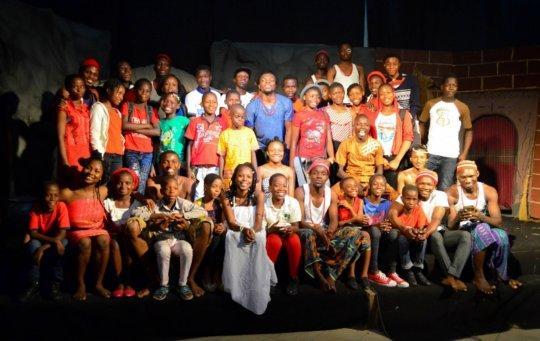 FLA Kids pose with actors of Ugonma