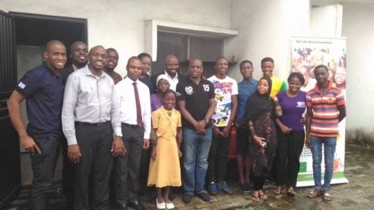 Damilola and his friends and family with the kids