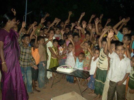 children with birth day cake