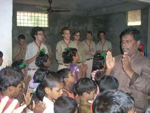 The french scout boys worship with the children
