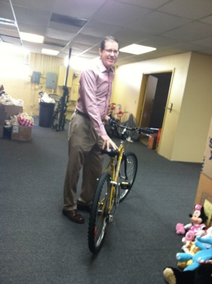 A volunteer displays a donated bicycle!