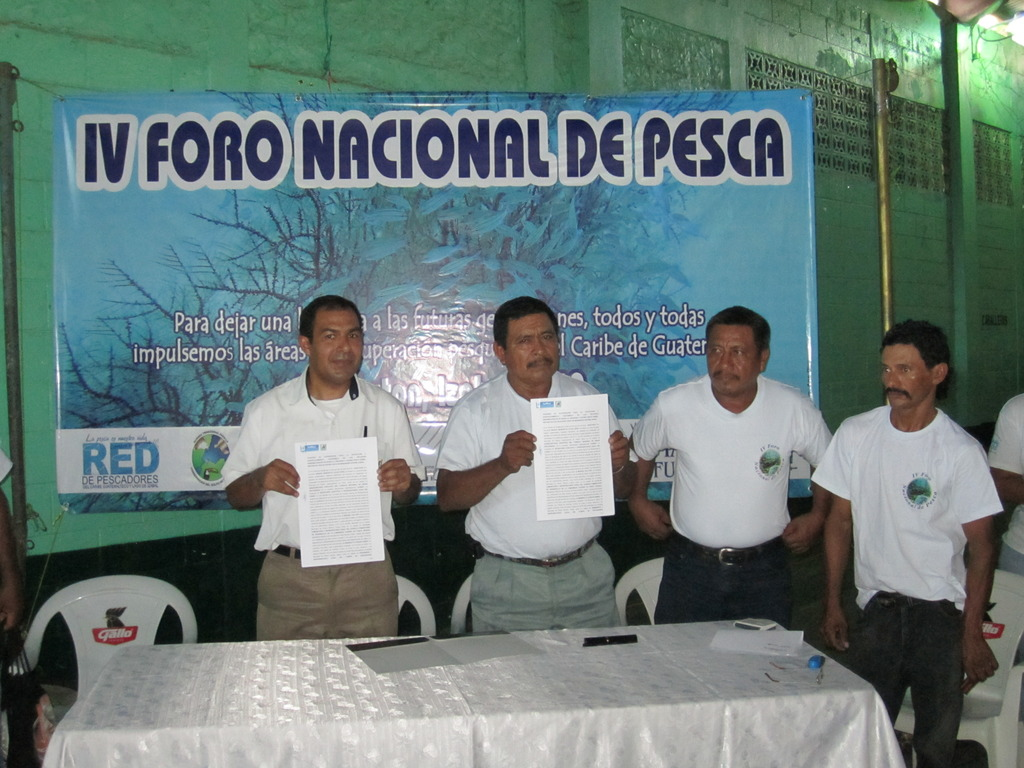 Authorities and fishers showing the agreement
