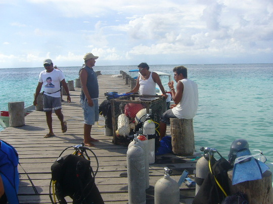The Puerto Morelos Cooperative preparing its scuba gear.