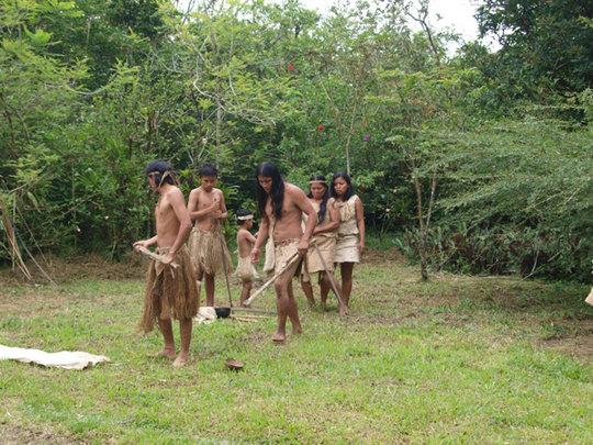 Maleku family demonstrating tribal cultures