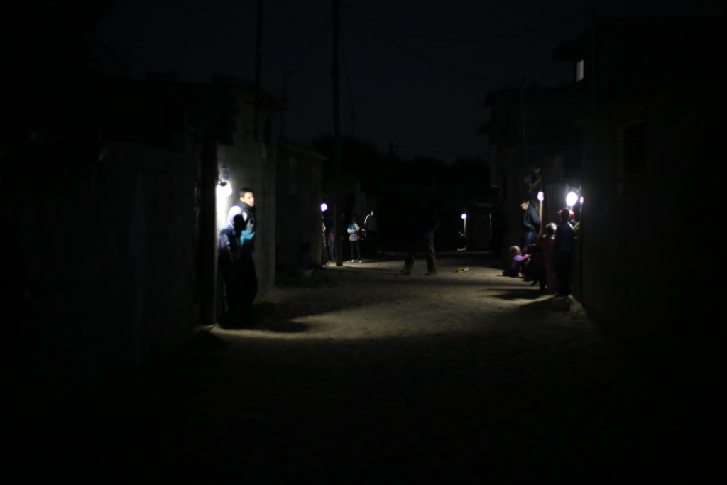 Families illuminate their street with Nur al-Amal