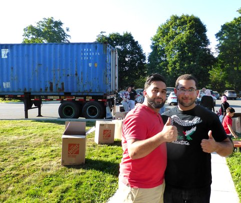 Adam and Ahmed load the container!