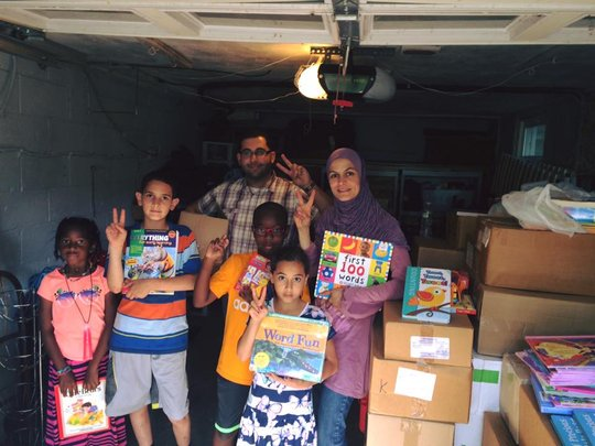 Our volunteers with hundreds of donated books!