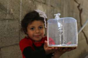 At her home, under repairs in Gaza