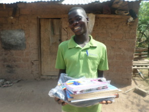 A child excited to have received school supplies