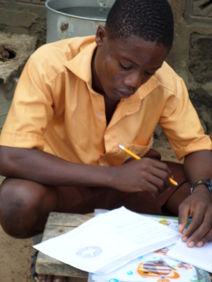 Emmanuel studying hard so he can become a teacher