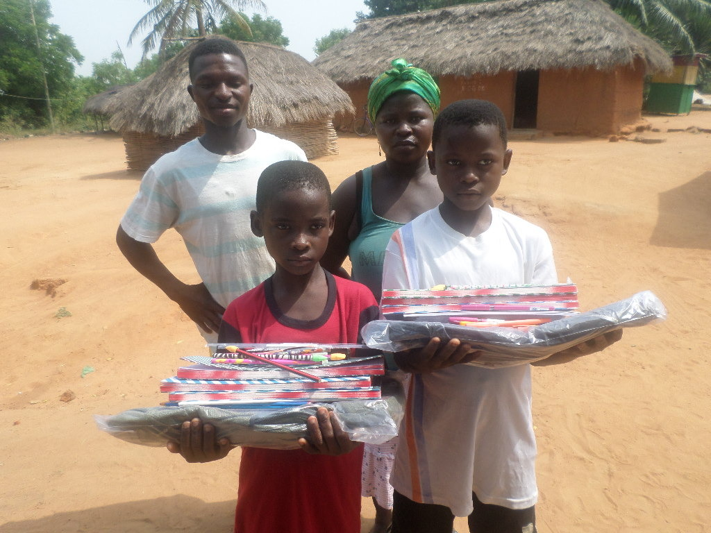 Children with family receiving school supplies