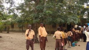 Kojo Tawiah looking happy to be in school
