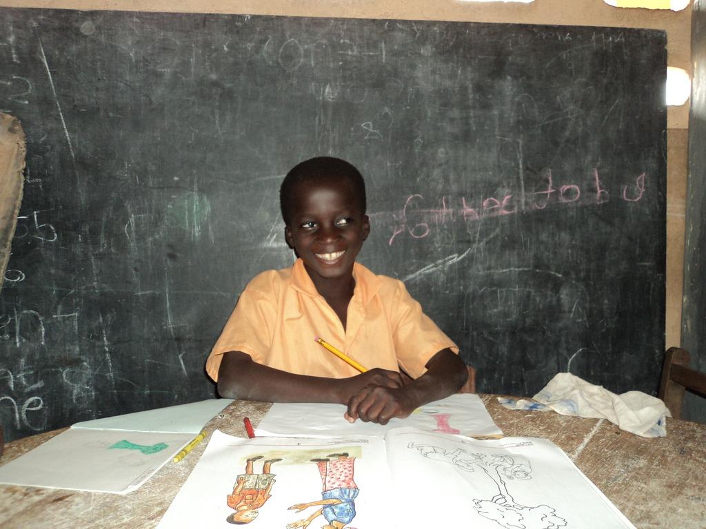 Paa Kwesi in School Smiling Broadly