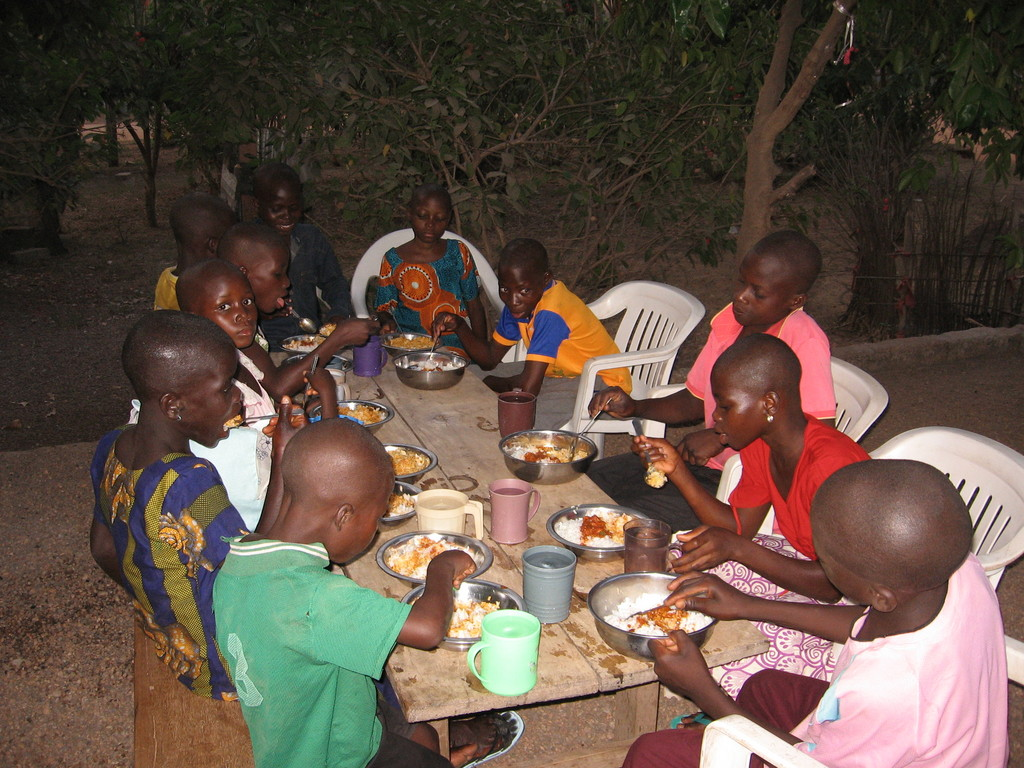 Kids at the transit camp having a meal together
