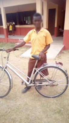 Roland with his bicycle in school