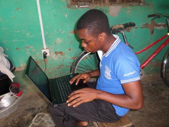 Simon with his new laptop