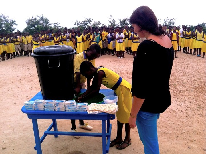 Students learn how to use the hand-washing station
