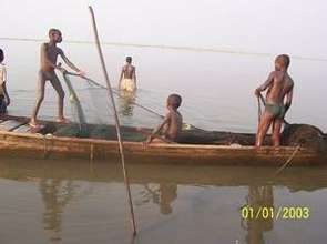 Trafficked children working on the lake