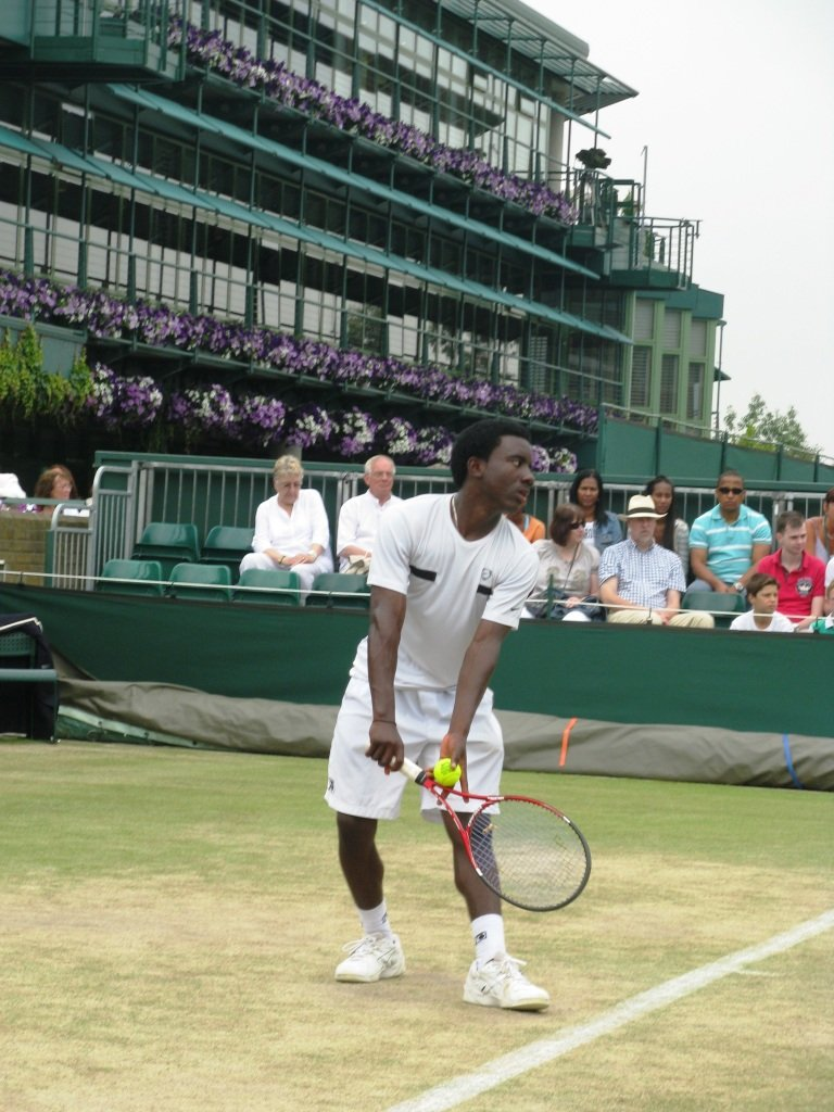 Hassan serves at Wimbledon