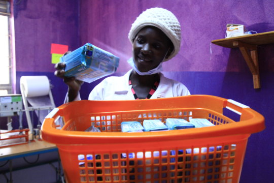 Young girls making sanitary pads for school girls