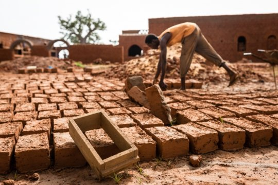 Adobe brick-making, photo by Regis Binard