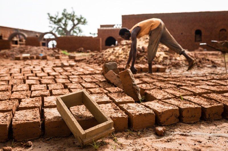 Adobe brick-making, photo by Regis Binard