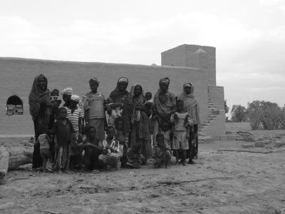 Villagers outside the mosque site