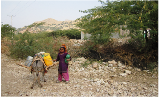 A Girl Fetching Water from Pond