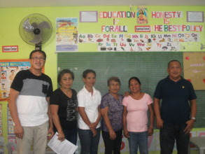 Day care center accreditor and barangay leaders
