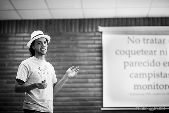 Guido, FDJE youth leader, leading camp protocol