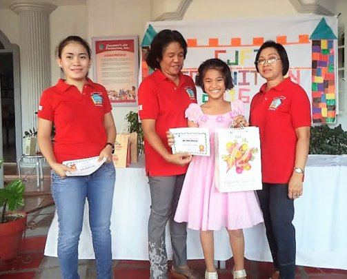 CJFI staff awards Joanna for her good performance.