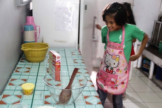The little chef in the kitchen is all set.