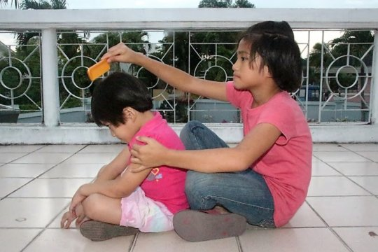 Joanna takes care of her younger sister well.