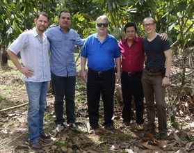 Project Leaders Pose in A Member's Cacao Field