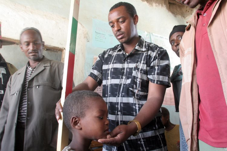 A health care worker assesses Abdulmejid