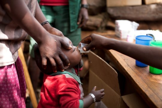A child receives their annual dose of antibiotics