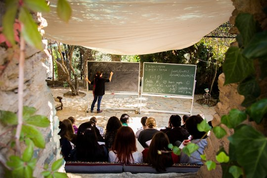 Students learning math at the  Mathematics Village