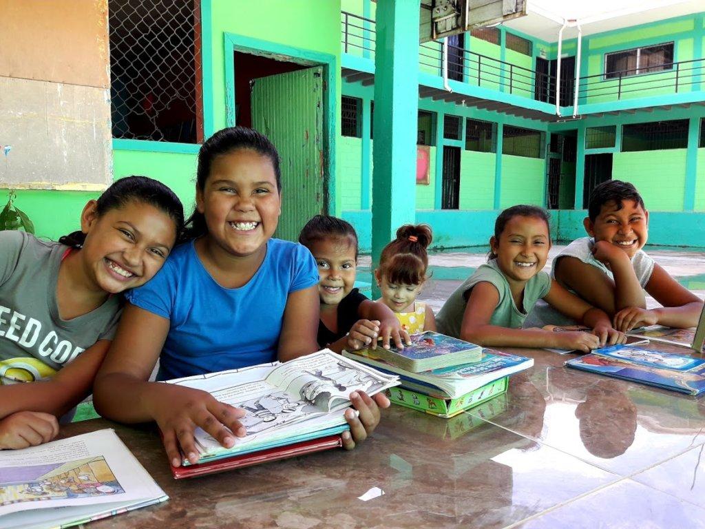 Girls enjoying reading