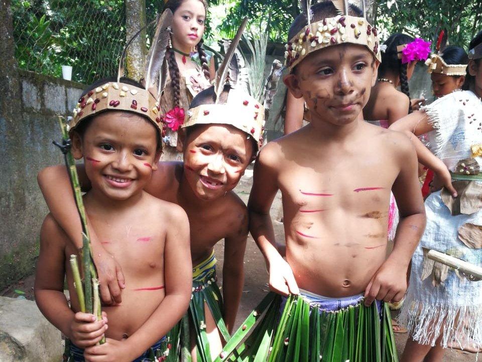 Children customizing the Indian Lempira