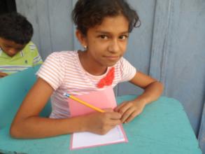 Maria writing a story for her friend Bibliobandido