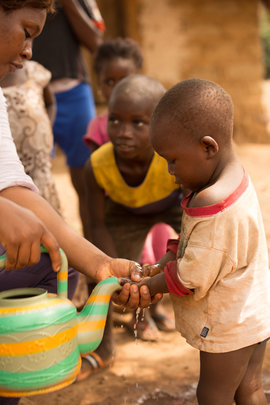 Guinea, May 2015. Community hand washing outreach